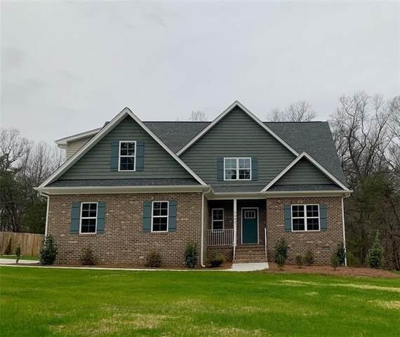 6909 Claren Oaks Court, Gibsonville, NC 27249 (MLS #108288) :: Nanette & Co.