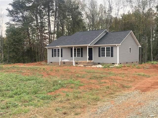 4981 Lee Lewis Road, Gibsonville, NC 27249 (MLS #112396) :: Nanette & Co.