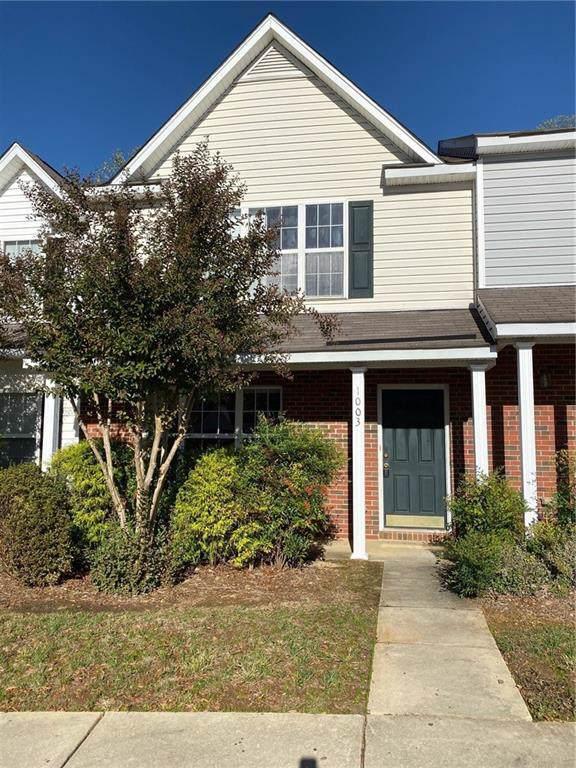 1003 Oak Blossom Way, Whitsett, NC 27377 (MLS #105845) :: Nanette & Co.