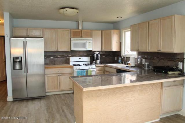 6574 Mulberry Drive, Anchorage, AK 99502 (MLS #17-17426) :: Northern Edge Real Estate, LLC