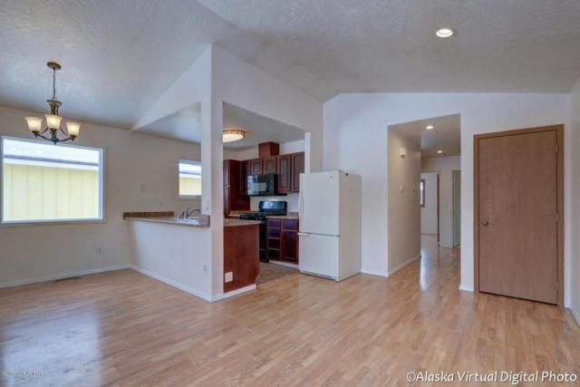 7805 Regal Mountain Circle, Anchorage, AK 99504 (MLS #18-3847) :: Channer Realty Group