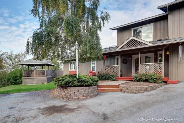 12112 Horseshoe Drive, Eagle River, AK 99577 (MLS #20-9744) :: Wolf Real Estate Professionals