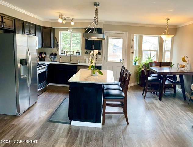 8223 Seaview Street, Anchorage, AK 99502 (MLS #21-6883) :: Powered By Lymburner Realty