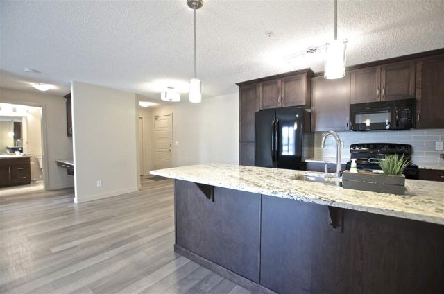332 6076 Schonsee Way, Edmonton, AB T5Z 0G8 (#E4115602) :: The Foundry Real Estate Company