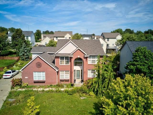 1392 Four Seasons Drive, Howell, MI 48843 (MLS #3269034) :: The Toth Team