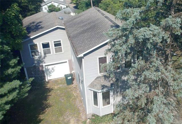 10273 Greenwood Rd, Whitmore Lake, MI 48189 (MLS #R218091301) :: The Toth Team