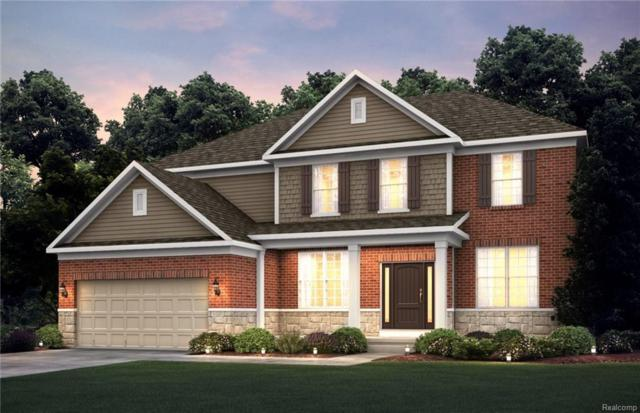 2009 Logan Dr, Rochester Hills, MI 48309 (MLS #R219013813) :: The Toth Team