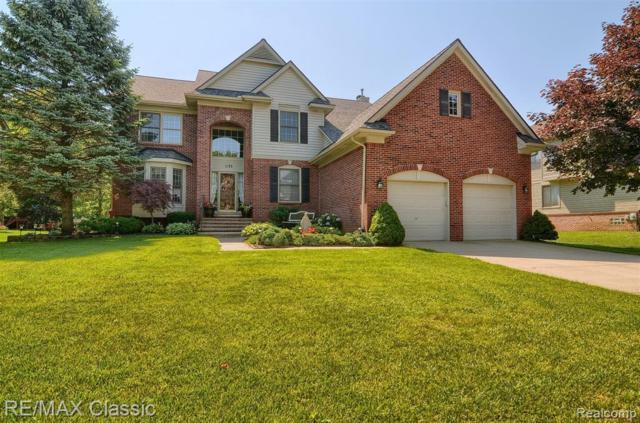 1135 Parkview Crt, Wixom, MI 48393 (MLS #R219066123) :: The Toth Team