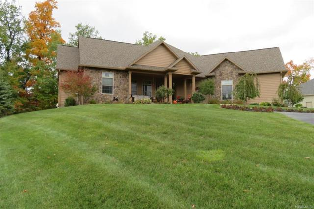 9112 Preserve Dr, Fenton, MI 48430 (MLS #R218101577) :: The Toth Team