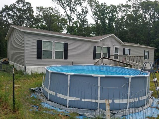 469383 815  BLACKJACK, Stilwell, OK 74960 (MLS #1087504) :: McNaughton Real Estate