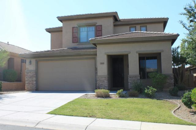 7135 W Desert Mirage Drive, Peoria, AZ 85383 (MLS #5624119) :: The Laughton Team