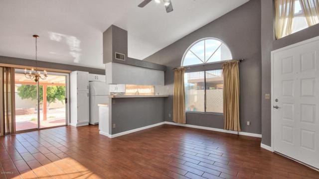 7637 W Shaw Butte Drive, Peoria, AZ 85345 (MLS #5636535) :: Devor Real Estate Associates