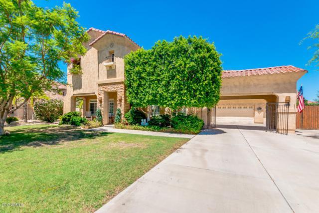 7184 W Cielo Grande Avenue W, Peoria, AZ 85383 (MLS #5646465) :: Kortright Group - West USA Realty