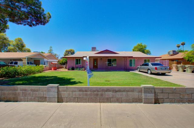 8334 N 55th Avenue, Glendale, AZ 85302 (MLS #5648357) :: The Laughton Team