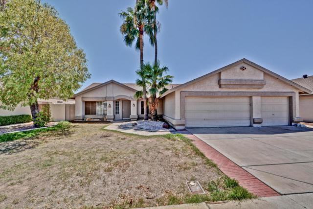 8409 W Surrey Avenue, Peoria, AZ 85381 (MLS #5649222) :: Brett Tanner Home Selling Team