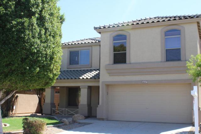 16547 W Rimrock Street, Surprise, AZ 85388 (MLS #5664261) :: Devor Real Estate Associates
