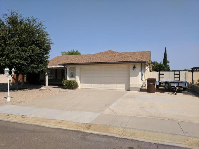 8611 W Village Drive, Peoria, AZ 85382 (MLS #5664340) :: Devor Real Estate Associates