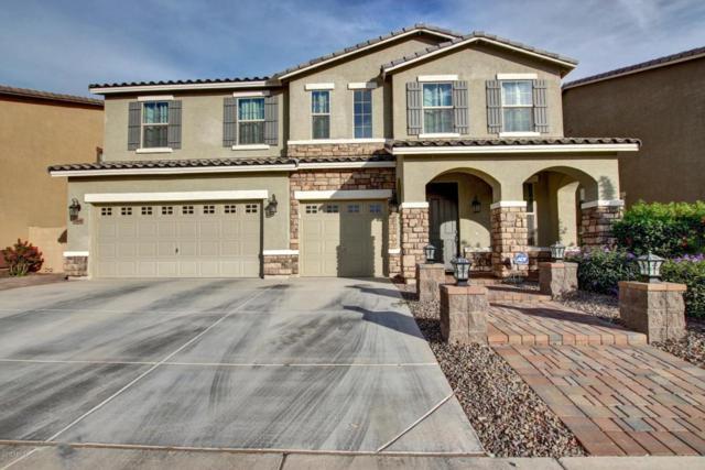 15849 N 182ND Lane, Surprise, AZ 85388 (MLS #5690097) :: Devor Real Estate Associates
