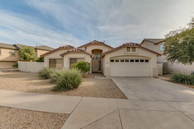 16423 W Woodlands Avenue, Goodyear, AZ 85338 (MLS #5690617) :: Devor Real Estate Associates