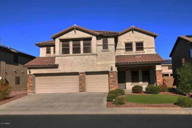 6382 W Victory Way, Florence, AZ 85132 (MLS #5696969) :: Yost Realty Group at RE/MAX Casa Grande