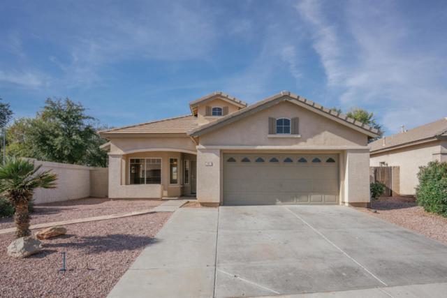 18 N 122ND Lane, Avondale, AZ 85323 (MLS #5710720) :: Brent & Brenda Team