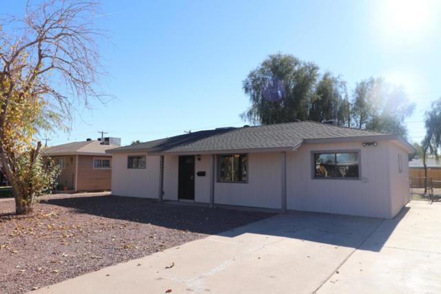 2941 W Griswold Road, Phoenix, AZ 85051 (MLS #5712360) :: Santizo Realty Group