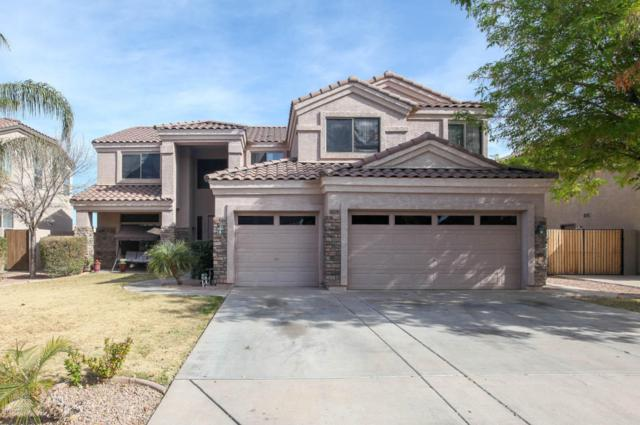 1109 S Roles Drive, Gilbert, AZ 85296 (MLS #5718356) :: Yost Realty Group at RE/MAX Casa Grande