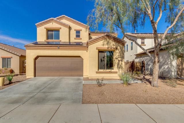 12042 W Leather Lane, Peoria, AZ 85383 (MLS #5727173) :: Devor Real Estate Associates