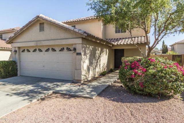 12746 W Cherry Hills Drive, El Mirage, AZ 85335 (MLS #5783704) :: Devor Real Estate Associates