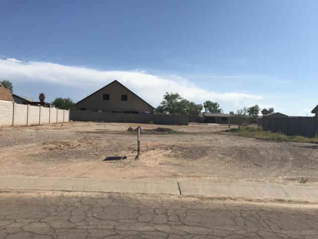 9823 W Heather Drive, Arizona City, AZ 85123 (MLS #5807267) :: Yost Realty Group at RE/MAX Casa Grande