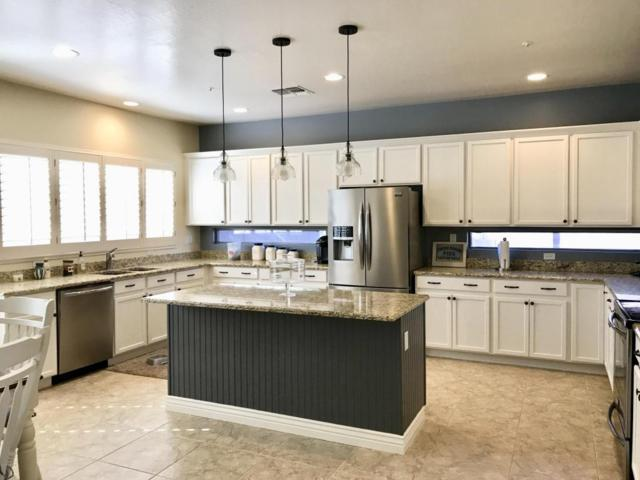 9827 W Sydney Way, Peoria, AZ 85383 (MLS #5807600) :: The W Group