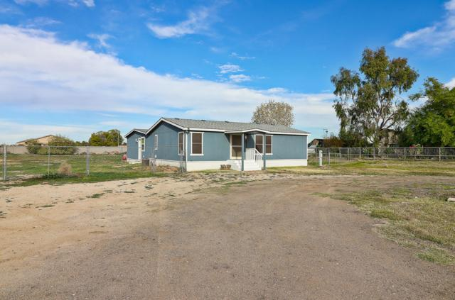 6825 N 176th Avenue, Waddell, AZ 85355 (MLS #5857433) :: Kortright Group - West USA Realty