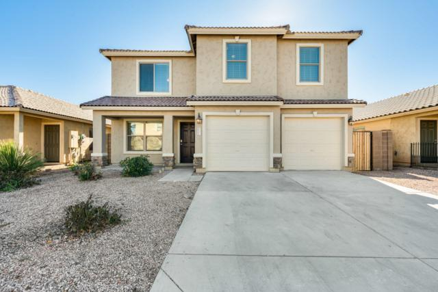 25175 W Parkside Lane S, Buckeye, AZ 85326 (MLS #5872025) :: The Laughton Team