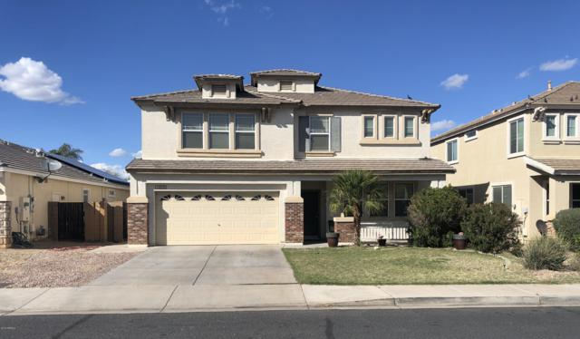 14976 W Wethersfield Road, Surprise, AZ 85379 (MLS #5894070) :: Yost Realty Group at RE/MAX Casa Grande