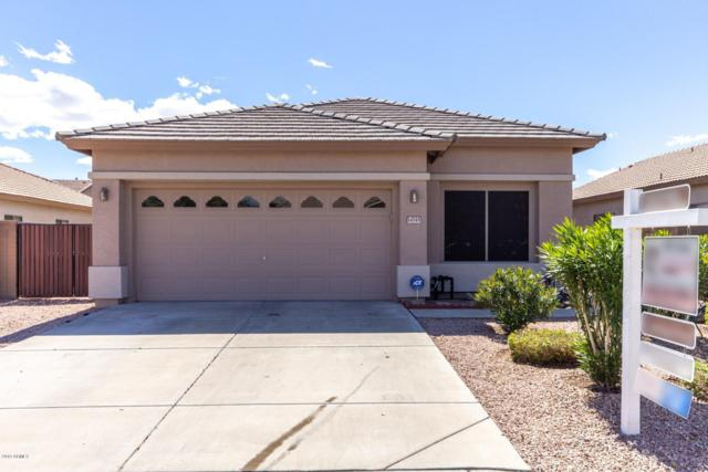 14545 W Hearn Road, Surprise, AZ 85379 (MLS #5896804) :: CC & Co. Real Estate Team