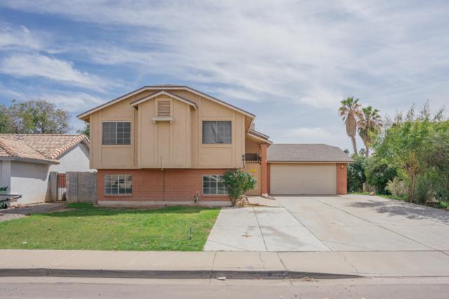 8913 W Virginia Avenue, Phoenix, AZ 85037 (MLS #5899470) :: neXGen Real Estate
