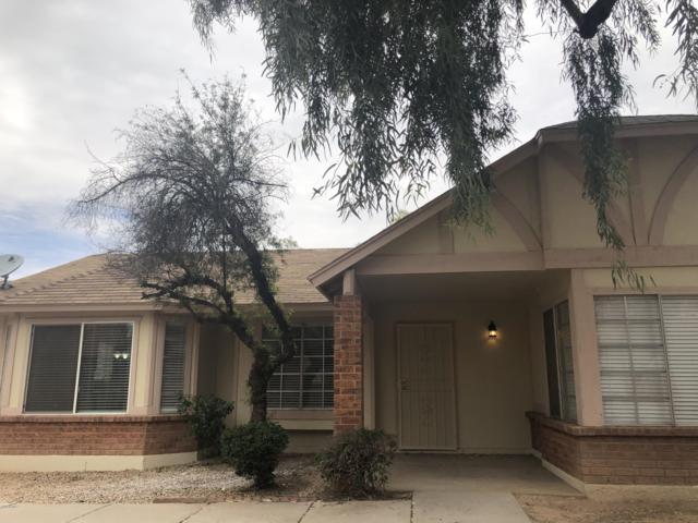 8520 W Palm Lane #1049, Phoenix, AZ 85037 (MLS #5900313) :: Yost Realty Group at RE/MAX Casa Grande