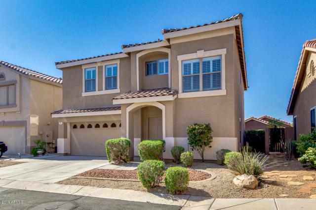 1711 W Amberwood Drive, Phoenix, AZ 85045 (MLS #5901568) :: Yost Realty Group at RE/MAX Casa Grande