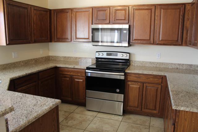 22807 W Gardenia Drive, Buckeye, AZ 85326 (MLS #5903652) :: Yost Realty Group at RE/MAX Casa Grande