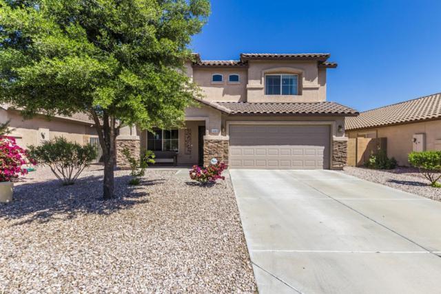 1441 S 219TH Drive, Buckeye, AZ 85326 (MLS #5903813) :: Yost Realty Group at RE/MAX Casa Grande