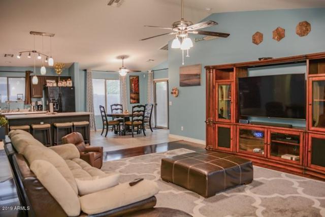 13949 W Maui Lane, Surprise, AZ 85379 (MLS #5913835) :: Yost Realty Group at RE/MAX Casa Grande