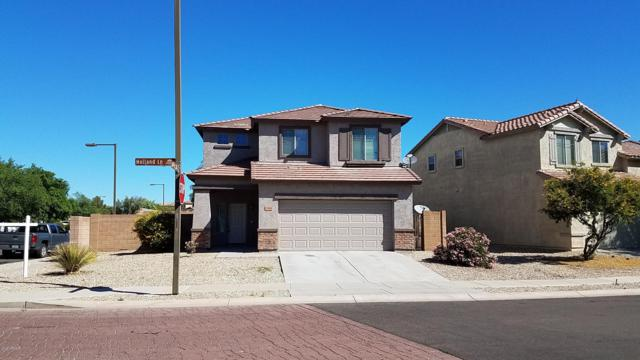 17426 W Holland Lane, Surprise, AZ 85388 (MLS #5914657) :: Kortright Group - West USA Realty