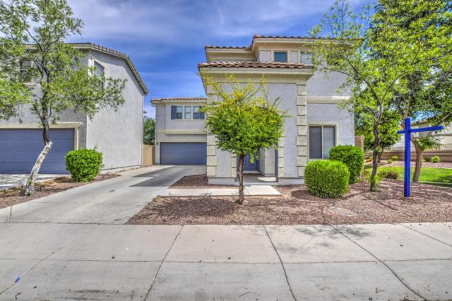 711 N 112TH Drive, Avondale, AZ 85323 (MLS #5914938) :: Devor Real Estate Associates