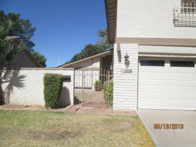 5628 S Jolly Roger Road, Tempe, AZ 85283 (MLS #5926140) :: CC & Co. Real Estate Team