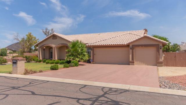 4664 W Soft Wind Drive, Glendale, AZ 85310 (MLS #5939547) :: Yost Realty Group at RE/MAX Casa Grande