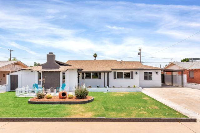 8219 E Clarendon Avenue, Scottsdale, AZ 85251 (MLS #5940227) :: Brett Tanner Home Selling Team