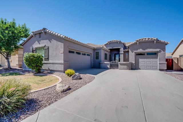 17574 W Gelding Drive, Surprise, AZ 85388 (MLS #5950340) :: CC & Co. Real Estate Team