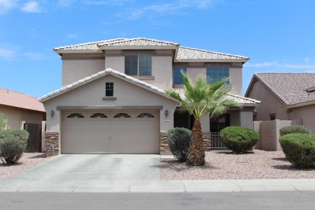 10046 W Veliana Way, Tolleson, AZ 85353 (MLS #5950683) :: CC & Co. Real Estate Team