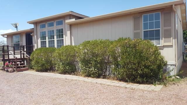 22148 W Gambit Trail, Wittmann, AZ 85361 (MLS #5962187) :: Yost Realty Group at RE/MAX Casa Grande