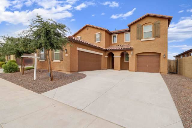 1658 N 214TH Lane, Buckeye, AZ 85396 (MLS #5971552) :: Riddle Realty Group - Keller Williams Arizona Realty
